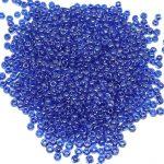 Toho Round 11/0 Codice produttore: 1057 Quantità:10gr Colore:inside color lt. sapphire opaque dk. blue lined Art P412